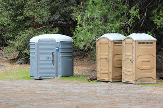 Large and small porta potties